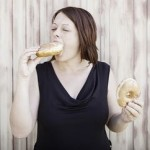 alt=girl eating donuts